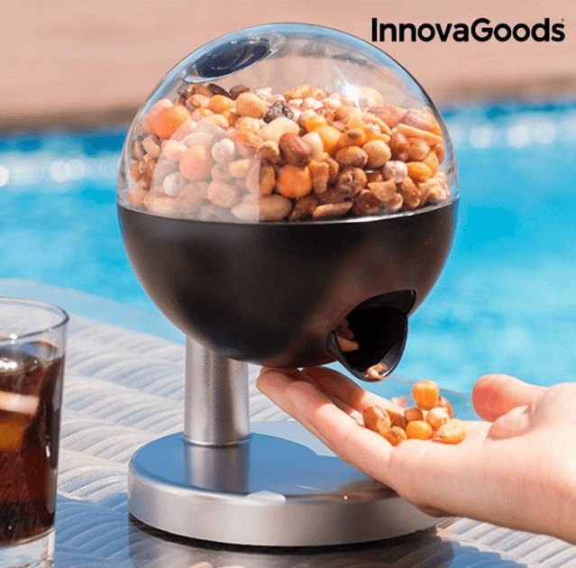 Dispenser med sensor til slik, nødder og lignende
